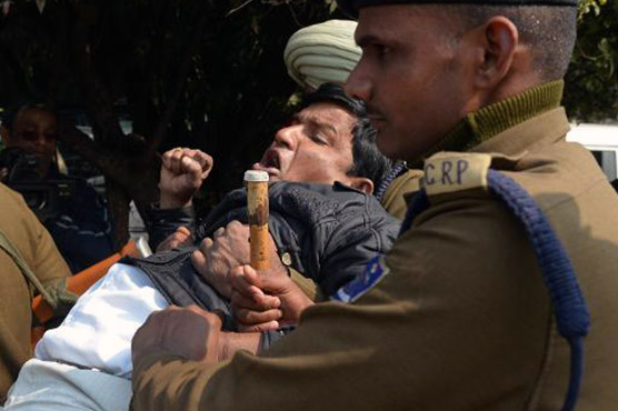 Pepper spray used amid ruckus in Indian parliament