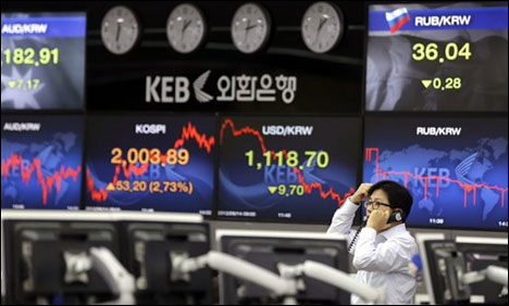 Asian shares mostly slip after Wall Street losses