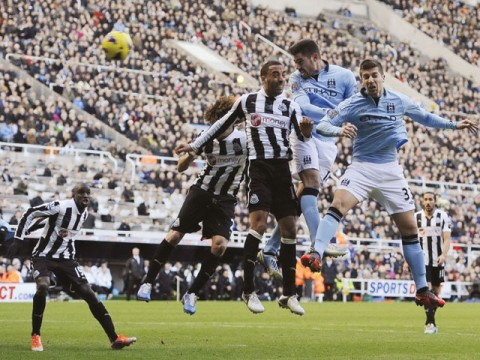 Man United hold course; City win