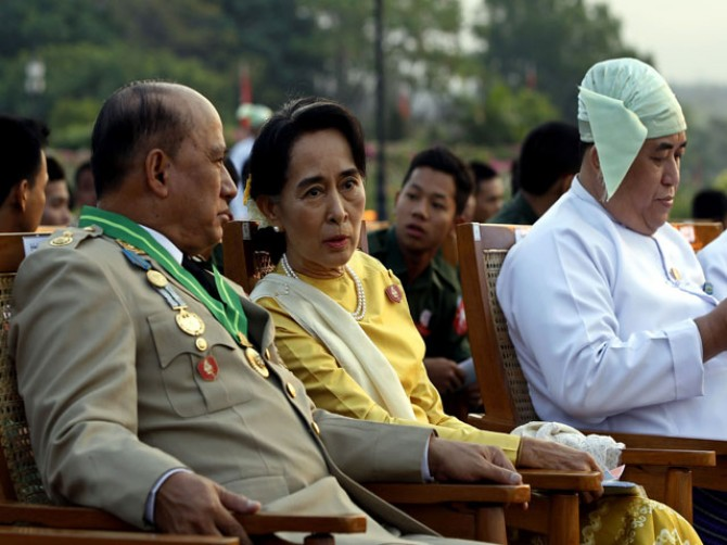 Myanmar showcases army might as unrest spreads
