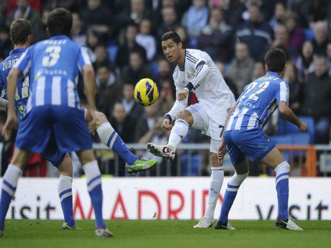 Ronaldo rescues Madrid, Barca cruise to victory
