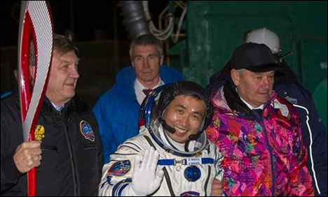 Olympic torch returns to earth after space walk