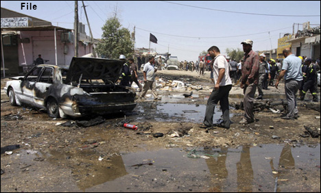String of bombings kill 12 in Iraq market: officials